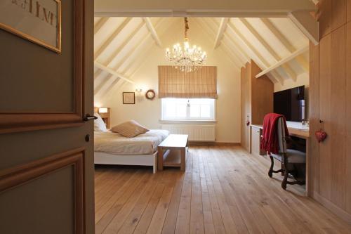 Een bed of bedden in een kamer bij B&B Villa Sans Soucis
