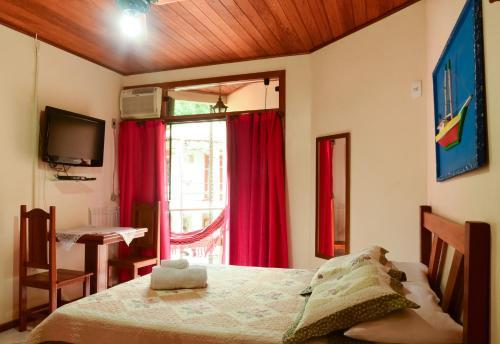 Cama ou camas em um quarto em Pousada Recanto do Sabiá
