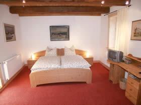 Ein Bett oder Betten in einem Zimmer der Unterkunft Pension Picco-Bello