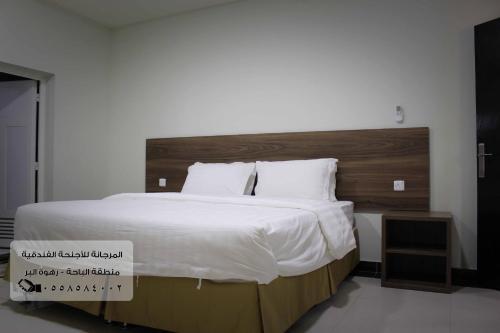 Cama ou camas em um quarto em Al Murjana Furnished Units - Families Only
