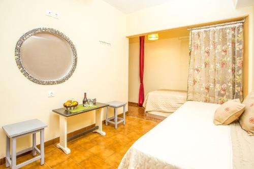 A bed or beds in a room at Takis Hotel Apartments