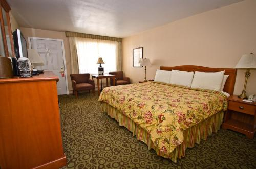 A bed or beds in a room at Ouray Chalet Inn