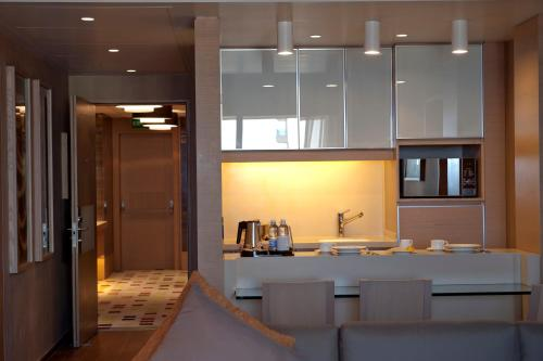 A kitchen or kitchenette at Saifi Suites