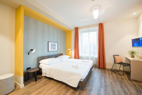 Letto o letti in una camera di Hotel Pestalozzi Lugano