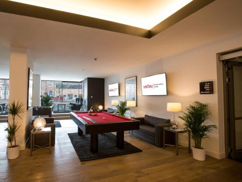 A pool table at DORMERO Hotel Altes Kaufhaus