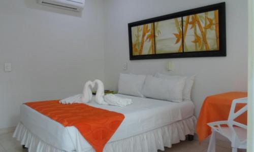 Cama o camas de una habitación en Hotel Zamba