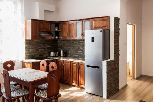Kuchnia lub aneks kuchenny w obiekcie Apartamenty Eden