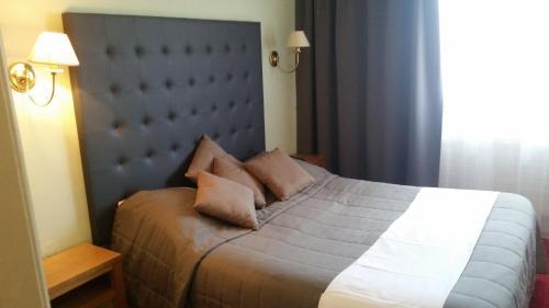 Un ou plusieurs lits dans un hébergement de l'établissement Hostellerie Reeb (Room Service disponible)