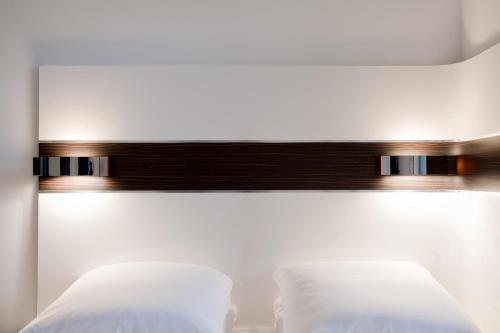 Een bed of bedden in een kamer bij Wakeup Copenhagen - Carsten Niebuhrs Gade
