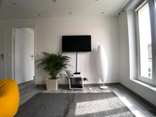 Télévision ou salle de divertissement dans l'établissement La Suite Emoji - SDP