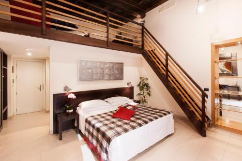A bed or beds in a room at Hotel De Petris