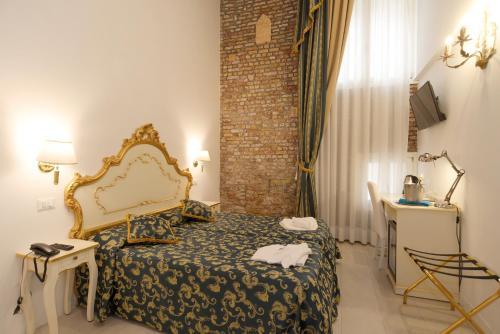 Un ou plusieurs lits dans un hébergement de l'établissement Al Mascaron Ridente
