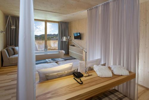 A bed or beds in a room at Tannenhof Sport & SPA