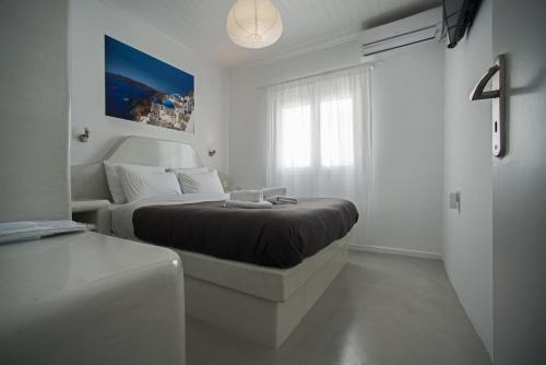 A bed or beds in a room at Corrado Caldera Apartments