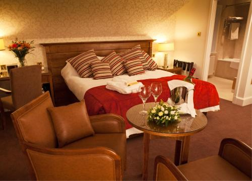 A bed or beds in a room at Grinkle Park Hotel