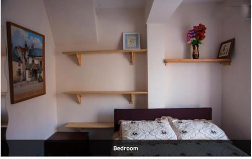 A bed or beds in a room at Rooms To Let In London