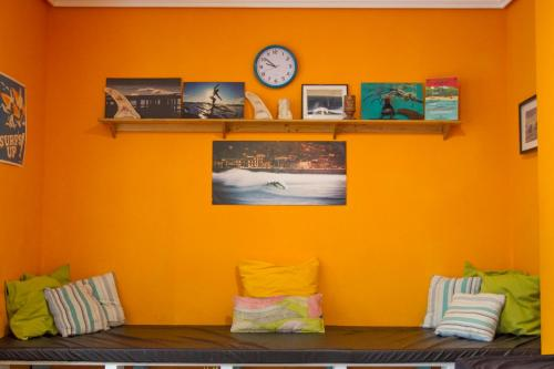 A television and/or entertainment center at Las Dunas Hostel