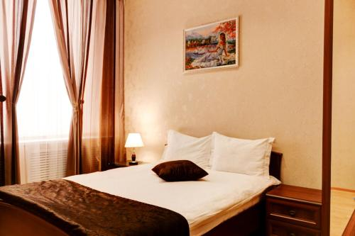 Кровать или кровати в номере Alfa Hotel