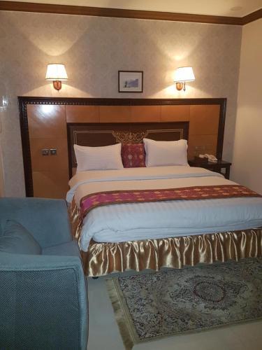 Cama ou camas em um quarto em Al Dor Al Watheer Residential Units