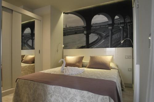 A bed or beds in a room at Apartamentos Sevilla Centro