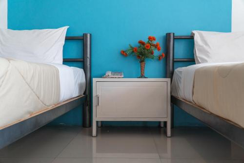 A bed or beds in a room at Noble House Chiangmai