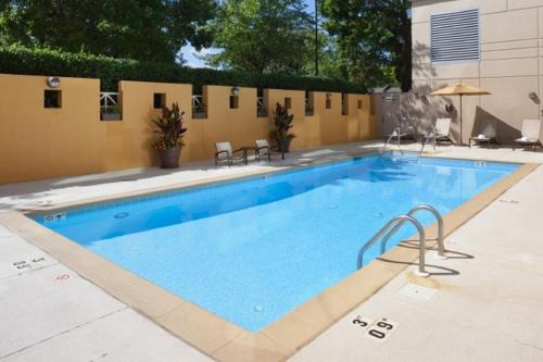 The swimming pool at or near DoubleTree by Hilton Charlotte Gateway Village