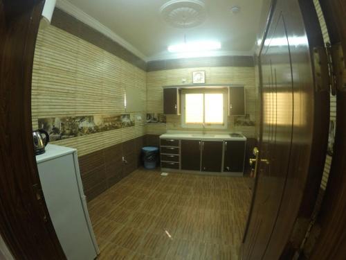 A cozinha ou cozinha compacta de Masat Al Badr Furnished Apartments
