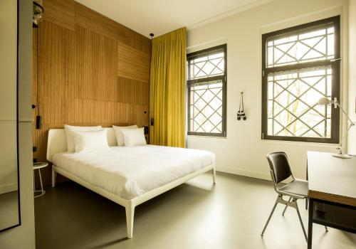 A bed or beds in a room at Conscious Hotel Westerpark