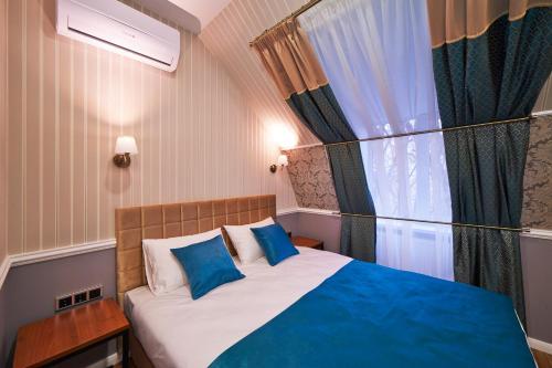 Кровать или кровати в номере Markell Hotel