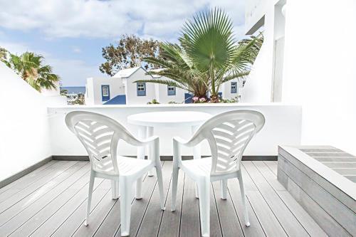 A balcony or terrace at Apartamentos Morromar THe Home Collection