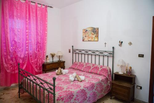 A bed or beds in a room at Casa Tartaruga