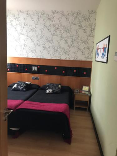 Cama o camas de una habitación en Hostal de Cuenca