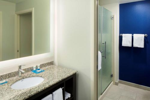A bathroom at Hyatt House Charlotte Center City