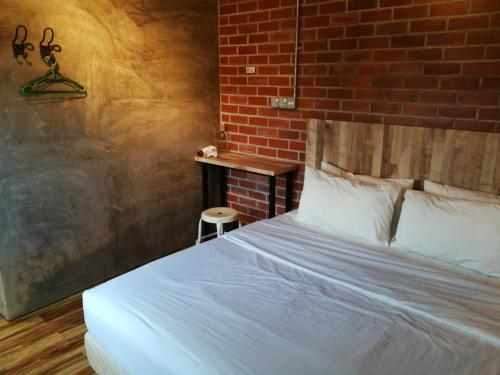 A bed or beds in a room at The Rise Room