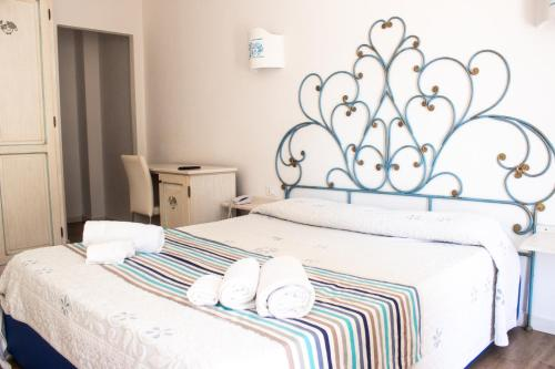 A bed or beds in a room at Olbia City Hotel