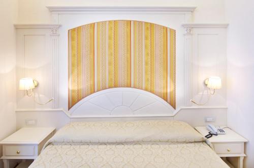 Letto o letti in una camera di Hotel Metropole Bellagio