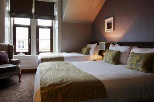 A bed or beds in a room at Angels Hotel