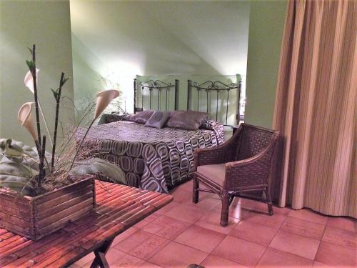 A bed or beds in a room at Hotel Baviera