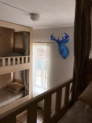 Двухъярусная кровать или двухъярусные кровати в номере Тревел-Центр и Хостел    52°17'