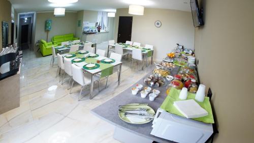 Ein Restaurant oder anderes Speiselokal in der Unterkunft Beverello Suite