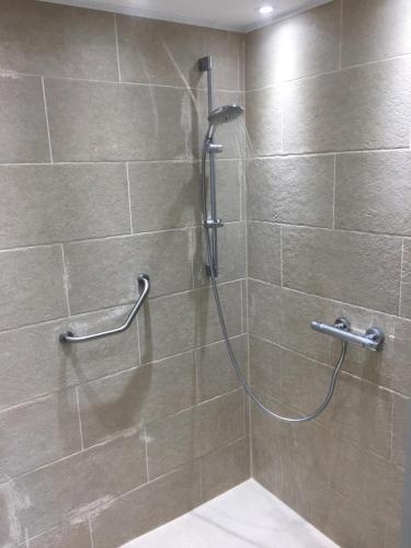 Een badkamer bij Check-Inn 1 - ADULTS ONLY