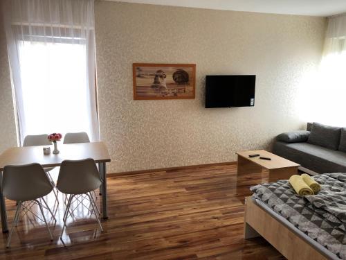 TV a/nebo společenská místnost v ubytování Evička Penzion