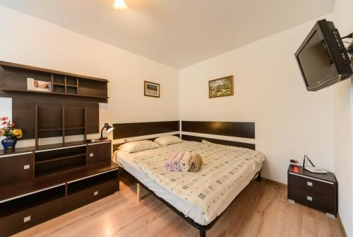 A bed or beds in a room at New appartment near Kyiv Airport