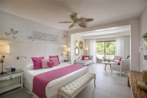 A bed or beds in a room at Catalonia Royal Bavaro - All Inclusive - Adults Only
