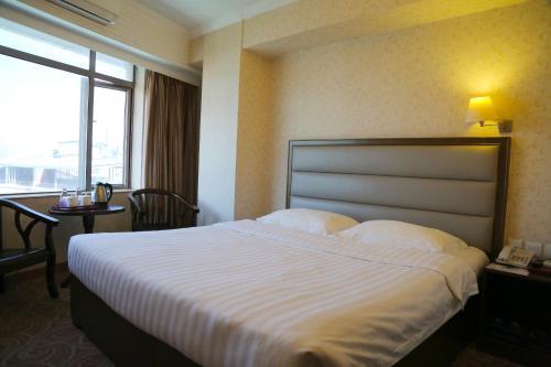 Un ou plusieurs lits dans un hébergement de l'établissement Towns Well Hotel