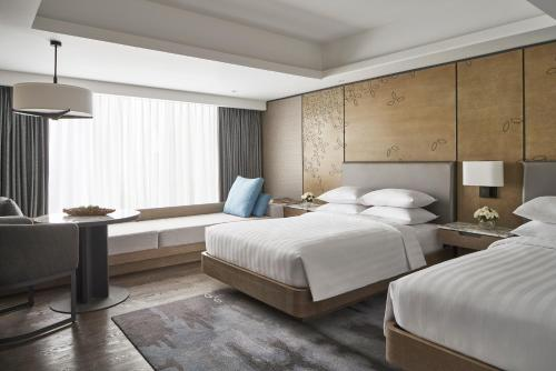 A bed or beds in a room at Yogyakarta Marriott Hotel