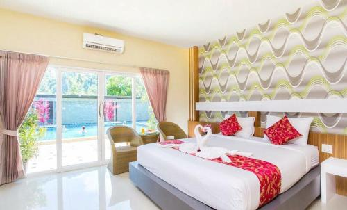 A bed or beds in a room at Phi Phi Maiyada Resort- SHA Certified Vaccinated
