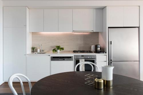 A kitchen or kitchenette at Beach Apartment Port Melbourne