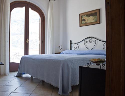 Letto o letti in una camera di Villa Palumbo B&B