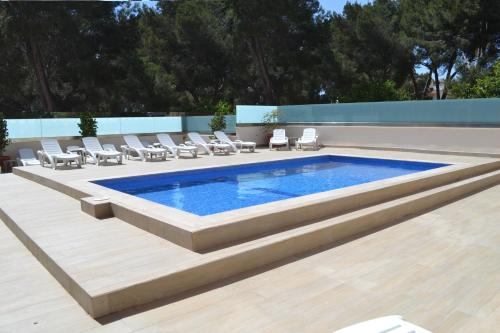 The swimming pool at or near Hotel Fenix